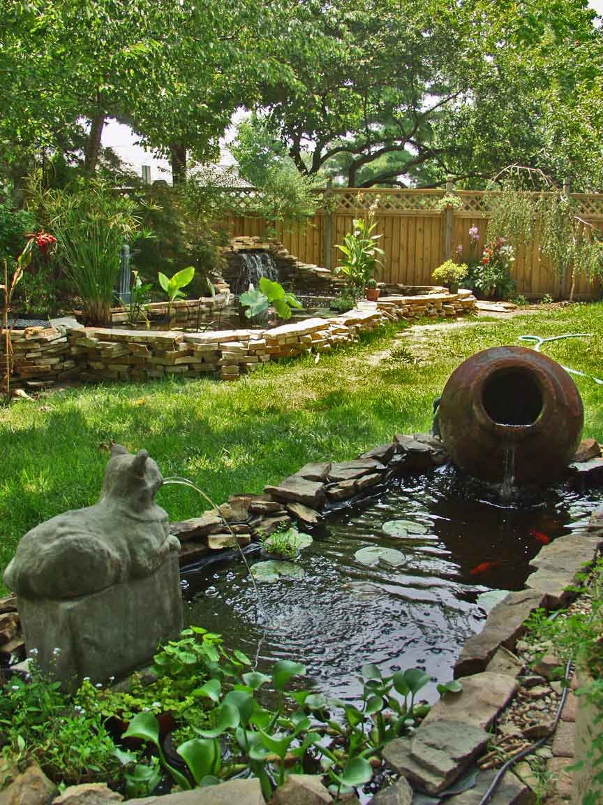 Wall and waterfall ideas p is for pond and patio for Outdoor yard ponds